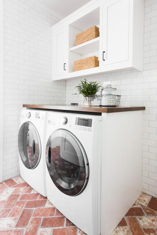 laundry room storage above washer and dryer