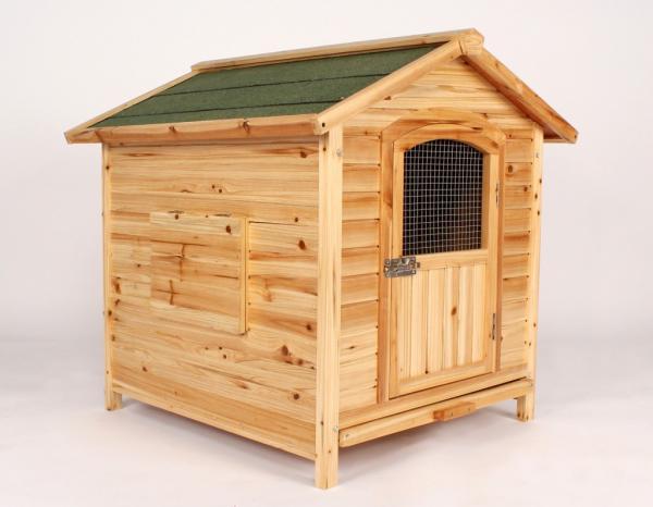 wooden dog house with door