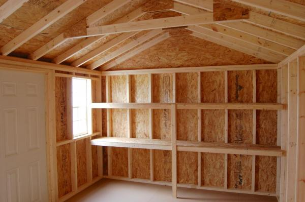 building storage loft above garage doors