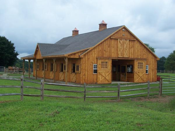 wood barndominium with return gable
