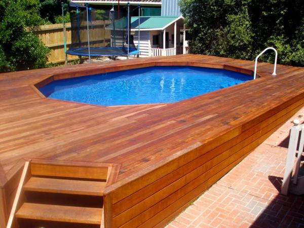 30 Above Ground Pool Deck Ideas With Steps To Build And The Cost